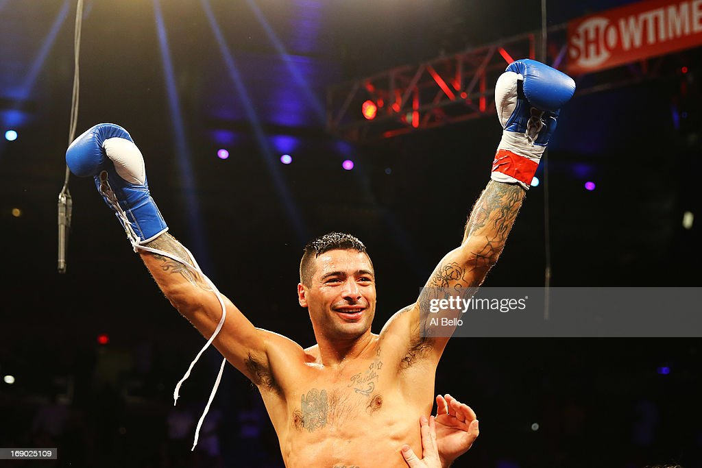 Lucas Matthysse celebrates his third round TKO win against Lamont Peterson during their Welterweight fight at Boardwalk Hall Arena on May 18, 2013 in Atlantic City, New Jersey.