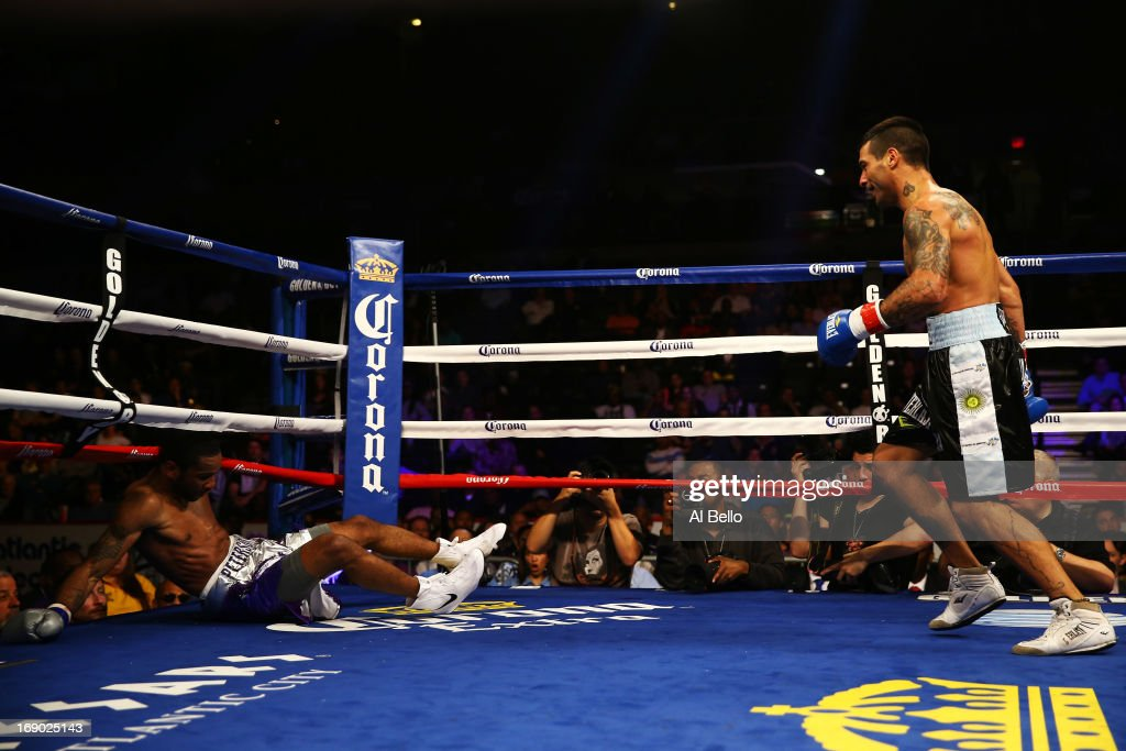 Lucas Matthysse knocks down Lamont Peterson in the second round on his way to a TKO win in the third during their Welterweight fight at Boardwalk Hall Arena on May 18, 2013 in Atlantic City, New Jersey.