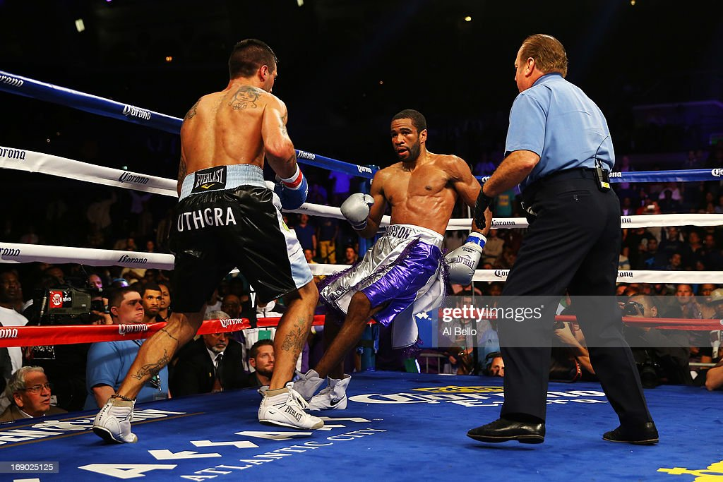 Lucas Matthysse knocks down Lamont Peterson in the third round on his way to a TKO win during their Welterweight fight at Boardwalk Hall Arena on May 18, 2013 in Atlantic City, New Jersey.