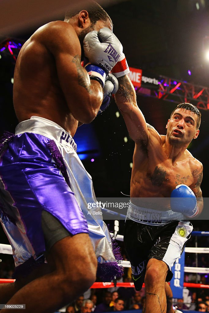 Lucas Matthysse punches Lamont Peterson in the third round on his way to a TKO win during their Welterweight fight at Boardwalk Hall Arena on May 18, 2013 in Atlantic City, New Jersey.