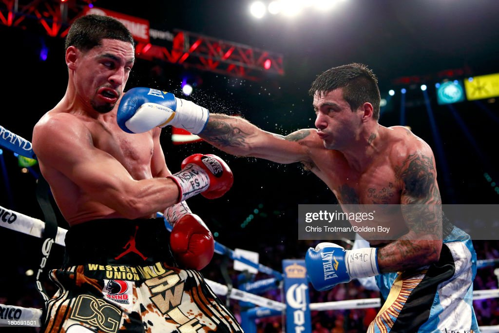 Lucas Matthysse throws a right at Danny Garcia during their WBC/WBA super lightweight title fight at the MGM Grand Garden Arena on September 14, 2013 in Las Vegas, Nevada.