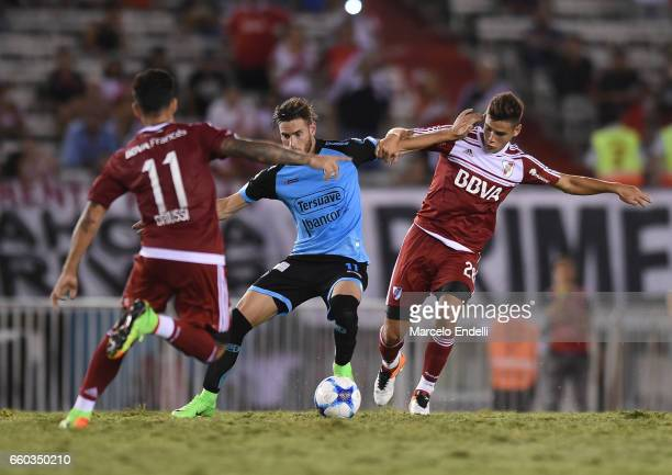 Lucas Melano of Belgrano fights for ball with Lucas Martinez Quarta of River Plate during a match between River Plate and Belgrano as part of Torneo...