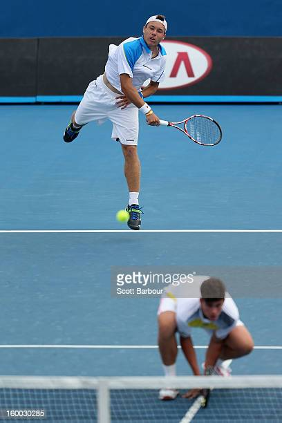 Lucas Miedler of Austria serves in his Junior Boys' Doubles Final match with Maximilian Marterer of Germany against Bradley Mousley and Jay Andrijic...