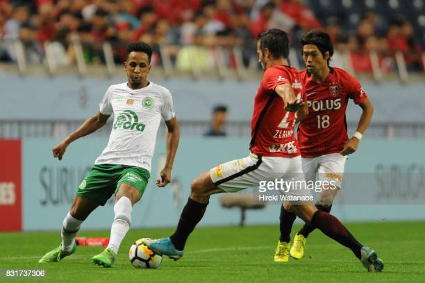 Lucas Mineiro of Chapecoense and Zlatan Ljubijankic of Urawa Red Diamonds compete for the ball during the Suruga Bank Championship match between...