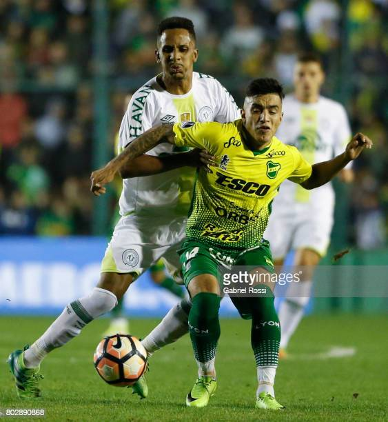 Lucas Mineiro of Chapecoense fights for the ball with Leonel Miranda of Defensa y Justicia during a first leg match between Defensa y Justicia and...