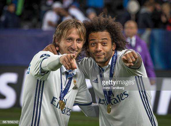 Lucas Modric and Marcello Real Madrid celebrate victory with Carlos Henrique Casimiro after theUEFA Super Cup match between Real Madrid and Sevilla...
