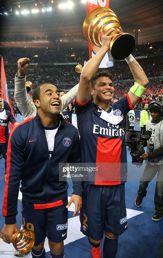 <a gi-track='captionPersonalityLinkClicked' href=/galleries/search?phrase=Lucas+Moura+-+Soccer+Midfielder+-+Born+1992&family=editorial&specificpeople=7910925 ng-click='$event.stopPropagation()'>Lucas Moura</a> and Thiago Silva of PSG celebrate the victory at the end of the French League Cup Final (finale de la Coupe de la Ligue) between Olympique Lyonnais OL and Paris Saint-Germain FC at Stade de France on April 19, 2014 in Saint Denis near Paris, France.