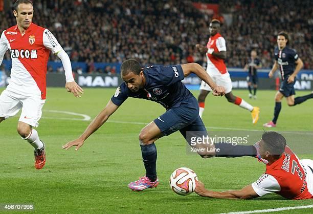 Lucas Moura of Paris SaintGermain and Ricardo Carvalho and Nabil Dirar of AS Monaco FC during the French Ligue 1 between Paris SaintGermain FC and AS...