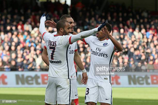 Lucas Moura of Paris SaintGermain celebrates his second goal with his teammate Layvin Kurzawa during the French League 1 match between EA Guingamp...
