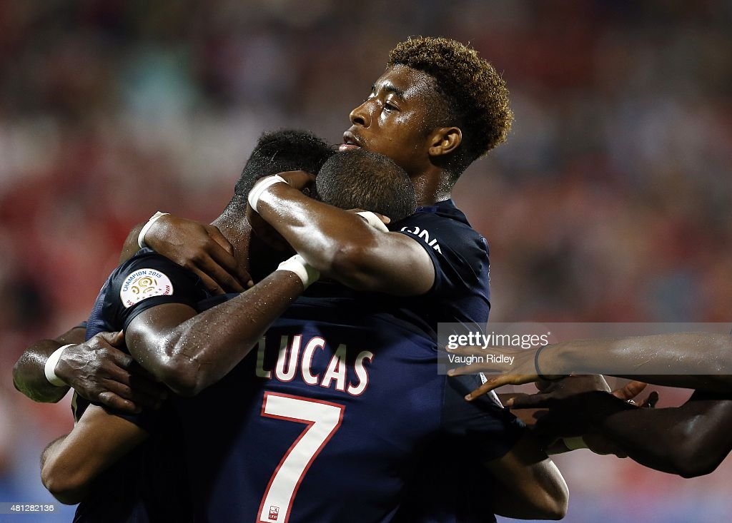 Lucas Moura #7 of Paris Saint-Germain is congratulated by teammates after scoring from the penalty spot during the 2015 International Champions Cup match against Benfica at BMO Field on July 18, 2015 in Toronto, Ontario, Canada.