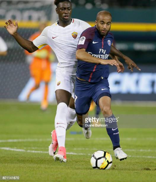 Lucas Moura of Paris SaintGermain is pursued by Moustapha Seck of AS Roma during the second half at Comerica Park on July 19 2017 in Detroit Michigan