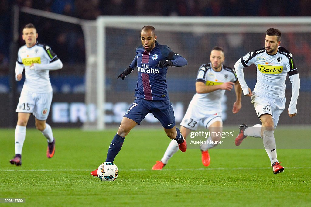 Lucas Moura of Paris Saint-Germain runs with the ball during the Ligue 1 match between Paris Saint-Germain and Angers SCO at Parc des Princes on November 30, 2016 in Paris, France.