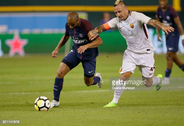 Lucas Moura of Paris SaintGermain tries to break away from Radja Nainggolan of AS Roma during the second half at Comerica Park on July 19 2017 in...