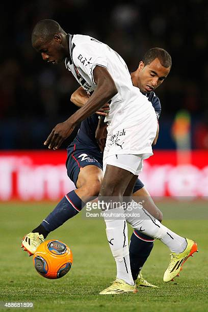 Lucas Moura of PSG and Abdoulaye Doucoure of Rennes battle for the ball during the Ligue 1 match between Paris SaintGermain FC and Stade Rennais FC...