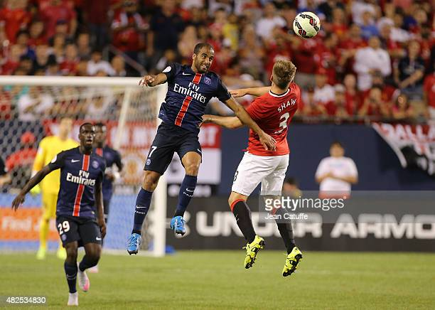 Lucas Moura of PSG and Lude Shaw of Manchester United in action during the International Champions Cup 2015 game between Manchester United and Paris...