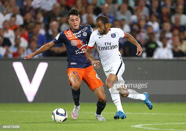 Lucas Moura of PSG and Ramy Bensebaini of Montpellier in action during the French Ligue 1 match between Montpellier Herault SC v Paris SaintGermain...