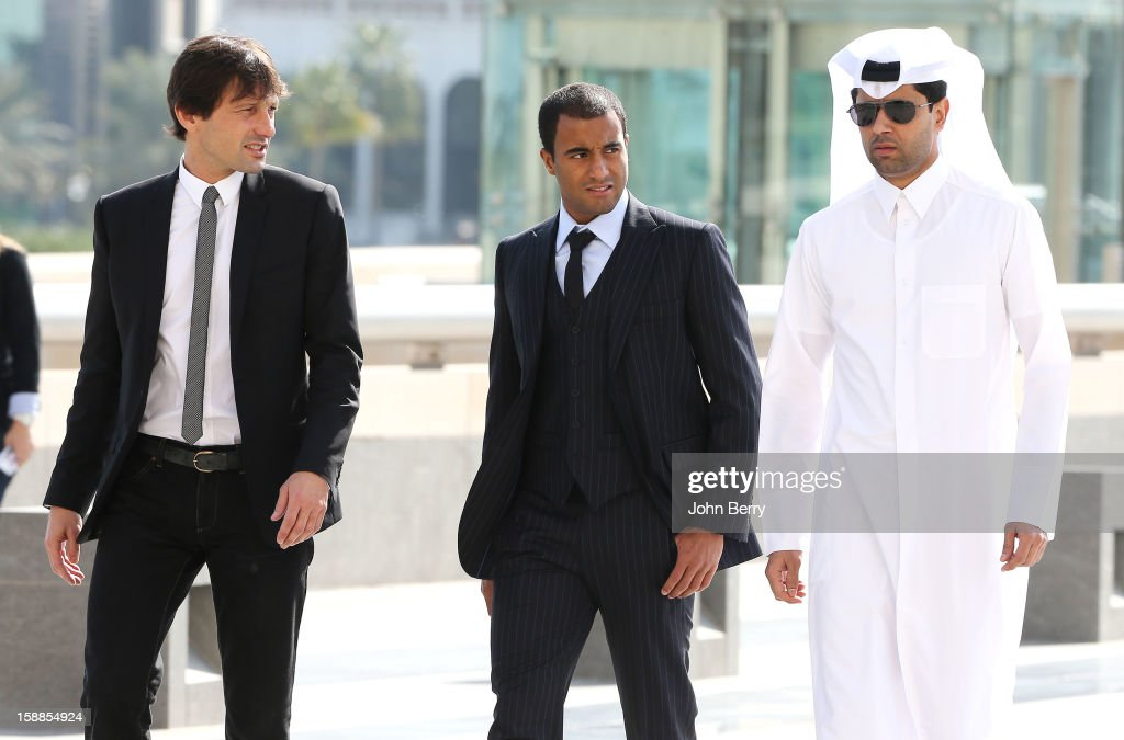 Lucas Moura of PSG attends his offical unveiling as a player of Paris Saint-Germain with Nasser Al-Khelaifi, president of PSG and Leonardo, manager of PSG during a press conference and jersey presentation at the Museum of Islamic Art on January 1, 2013 in Doha, Qatar.