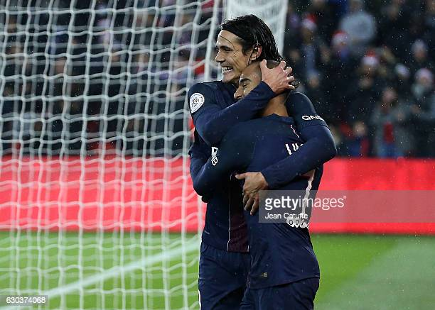Lucas Moura of PSG celebrates his goal with Edinson Cavani of PSG during the French Ligue 1 match between Paris SaintGermain and FC Lorient at Parc...