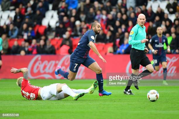 Lucas Moura of PSG escapes from Erick Cabaco of Nancy during the French Ligue 1 match between Paris Saint Germain and Nancy at Parc des Princes on...