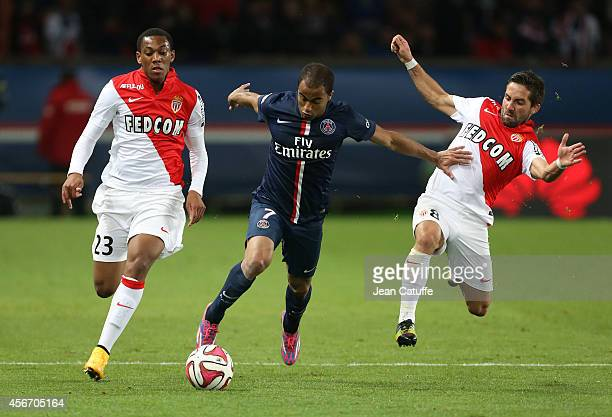 Lucas Moura of PSG in action between Anthony Martial and Joao Moutinho of Monaco during the French Ligue 1 match between Paris SaintGermain FC and AS...