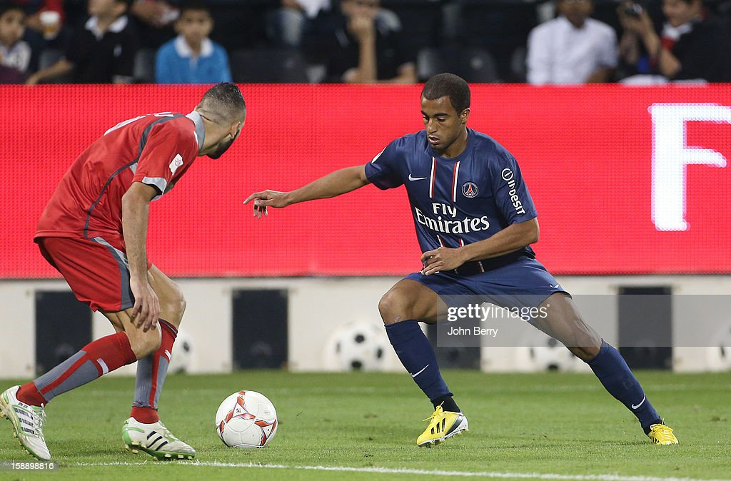 <a gi-track='captionPersonalityLinkClicked' href=/galleries/search?phrase=Lucas+Moura+-+Soccer+Midfielder+-+Born+1992&family=editorial&specificpeople=7910925 ng-click='$event.stopPropagation()'>Lucas Moura</a> of PSG in action during the friendly match between Paris Saint-Germain FC and Lekhwiya Sports Club at the Al-Sadd Sports Club stadium on January 2, 2013 in Doha, Qatar.