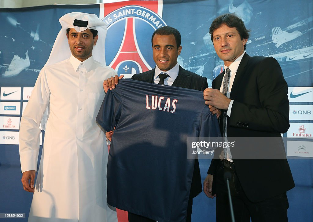 <a gi-track='captionPersonalityLinkClicked' href=/galleries/search?phrase=Lucas+Moura+-+Attacking+Midfielder+and+Winger+-+Born+1992&family=editorial&specificpeople=7910925 ng-click='$event.stopPropagation()'>Lucas Moura</a> of PSG poses with a shirt at his offical unveiling as a player of Paris Saint-Germain with <a gi-track='captionPersonalityLinkClicked' href=/galleries/search?phrase=Nasser+Al-Khelaifi&family=editorial&specificpeople=7941556 ng-click='$event.stopPropagation()'>Nasser Al-Khelaifi</a>, president of PSG and Leonardo, manager of PSG during a press conference and jersey presentation at the Museum of Islamic Art on January 1, 2013 in Doha, Qatar.
