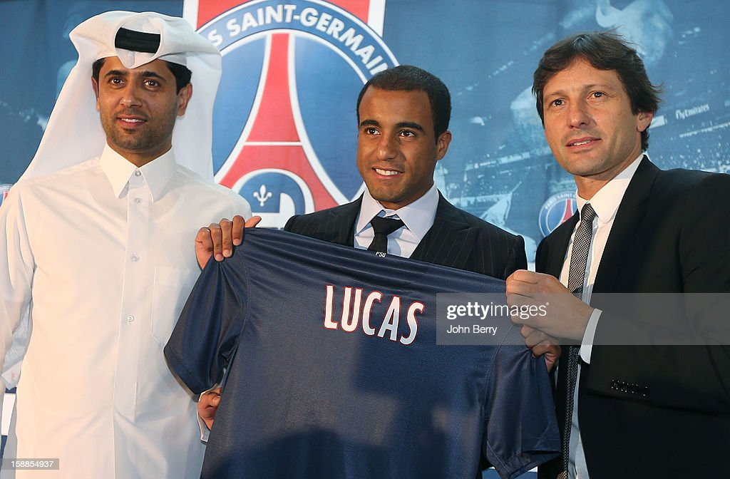 Lucas Moura of PSG poses with a shirt at his offical unveiling as a player of Paris Saint-Germain with Nasser Al-Khelaifi, president of PSG and Leonardo, manager of PSG during a press conference and jersey presentation at the Museum of Islamic Art on January 1, 2013 in Doha, Qatar.