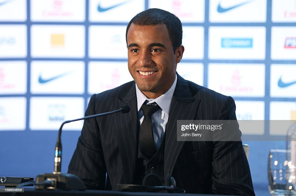 Lucas Moura of PSG smiles during his official unveiling as a player of Paris Saint-Germain at a press conference and a jersey presentation with Nasser Al-Khelaifi, president of PSG and Leonardo, manager of PSG, at the Museum of Islamic Art on January 1, 2013 in Doha, Qatar.