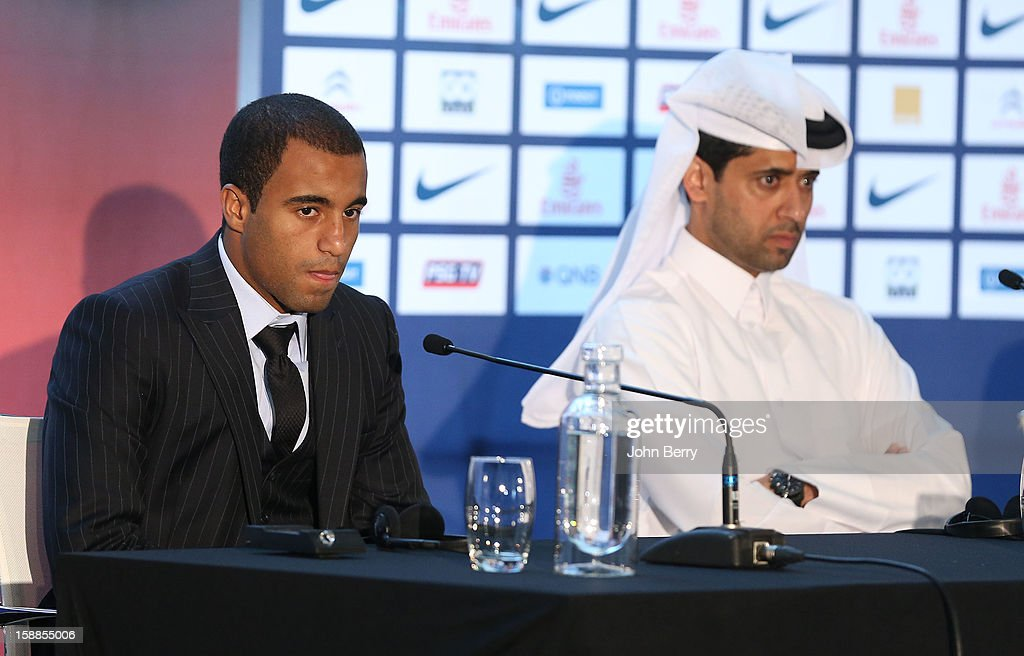 Lucas Moura of PSG speaks to members of the media next to Nasser Al-Khelaifi, president of PSG during his official unveiling as a player of Paris Saint-Germain at a press conference and jersey presentation at the Museum of Islamic Art on January 1, 2013 in Doha, Qatar.