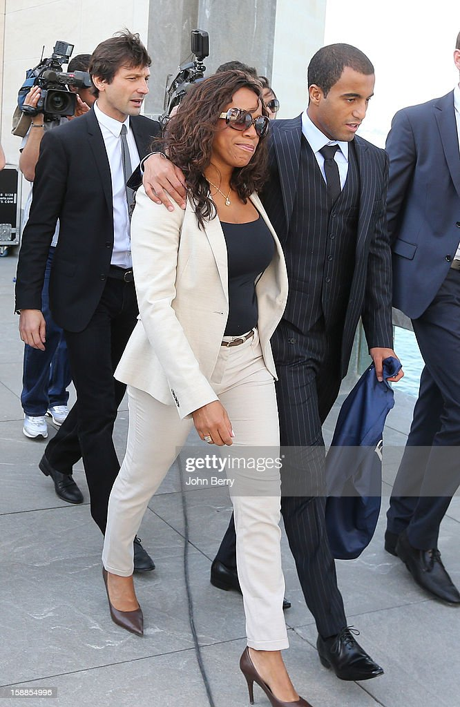 Lucas Moura of PSG walks with his mother Maria de Fatima and Leonardo, manager of PSG, during his official unveiling as a player of Paris Saint-Germain at a press conference and jersey presentation at the Museum of Islamic Art on January 1, 2013 in Doha, Qatar.