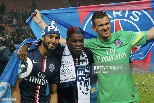 Lucas Moura Serge Aurier and Nicolas Douchez of Paris SaintGermain celebrate the victory after the French Ligue 1 game between Paris SaintGermain FC...