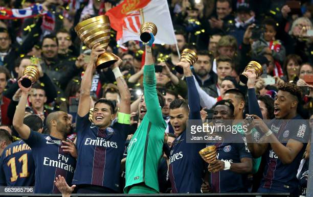 Lucas Moura Thiago Silva goalkeeper of PSG Kevin Trapp Hatem Ben Arfa Serge Aurier Presnel Kimpembe celebrate the victory following the French League...