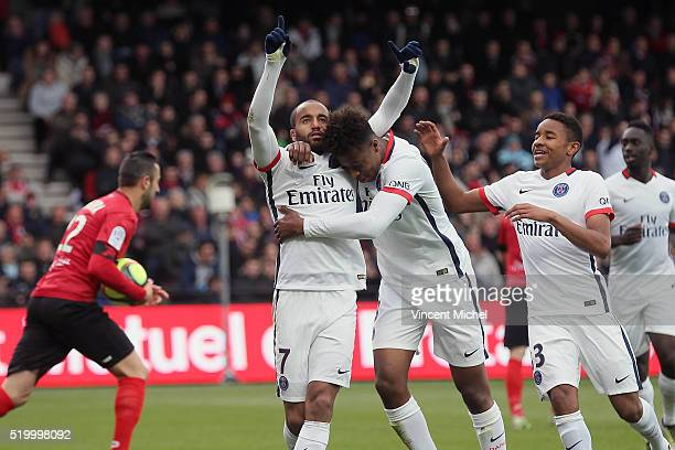 Lucas Moura with the team of Paris SaintGermain jubilates as he scores the first goal during the French League 1 match between EA Guingamp and Paris...