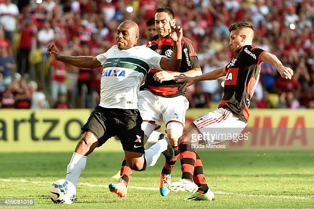 Lucas Mugni of Flamengo battles for the ball with a Luccas Claro of Coritiba during a match between Flamengo and Coritiba as part of Brasileirao...