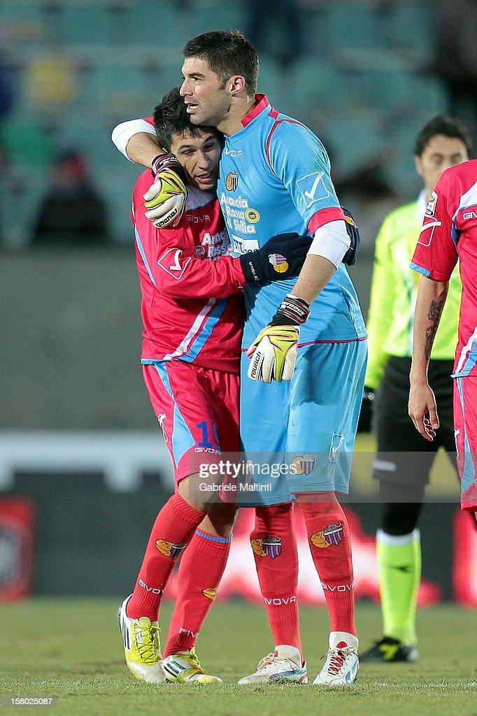 Lucas Nahuel Castro and Mariano Gonzalo Andujar of Calcio Catania celebrate their victory after the Serie A match between AC Siena and Calcio Catania...