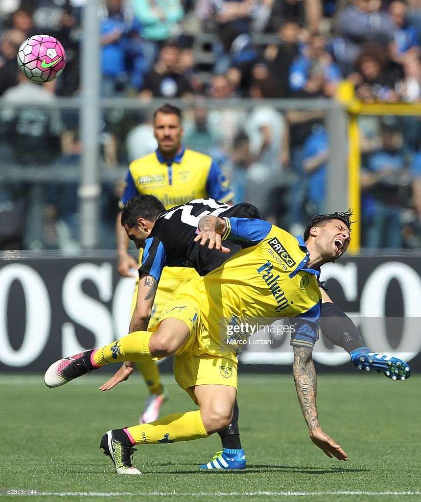 Lucas Nahuel Castro of AC Chievo Verona competes for the ball with Davide Brivio of Atalanta BC during the Serie A match between Atalanta BC and AC...