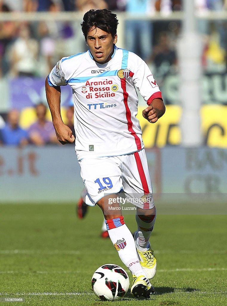 Lucas Nahuel Castro of Calcio Catania in action during the Serie A match between ACF Fiorentina and Calcio Catania at Stadio Artemio Franchi on...