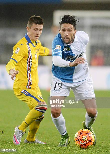 Lucas Nahuel Castro of Chievo Verona competes with David Ivan of UC Sampdoria during the Serie A match between AC Chievo Verona and UC Sampdoria at...