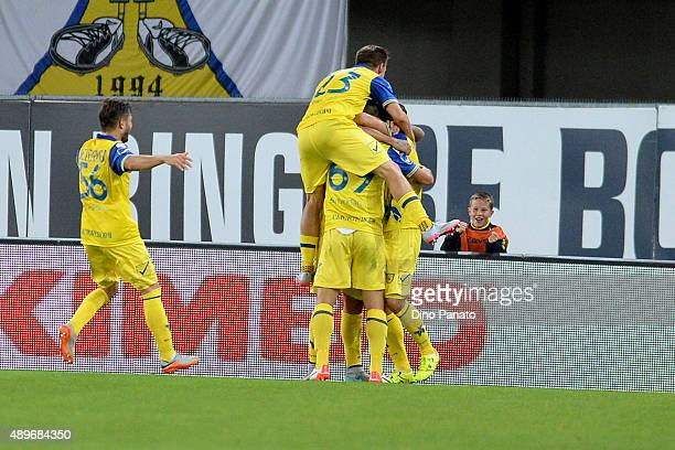 Lucas Nahuel Castro of Chievo Verona is mobbed by team mates after scoring his opening goal during the Serie A match between AC Chievo Verona and...
