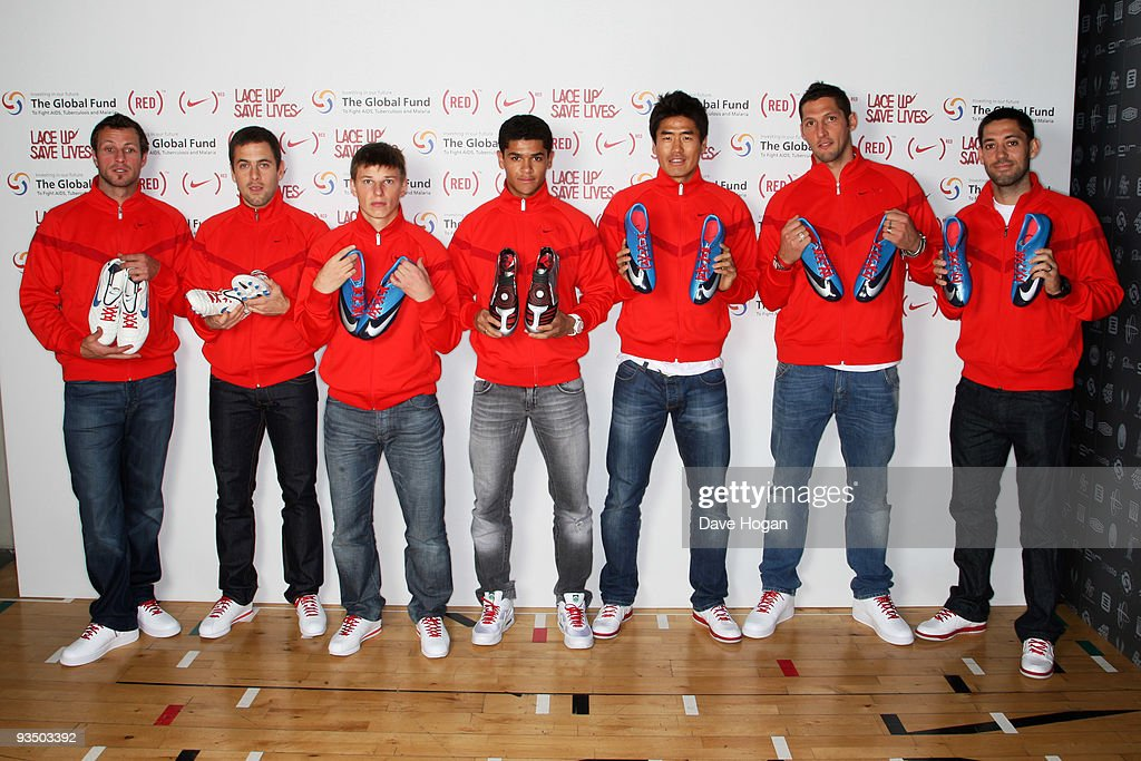 Lucas Neil, Joe Cole, Andrei Arshavin, Denilson, Seol Ki-Hyeon, Marco Materazzi and Clint Dempsey attend the NIKE & (RED) Charity Announcement at NikeTown on November 30, 2009 in London, England. On the day before World Aids day some of the world's best footballers joined Bono at an announcement of the partnership between NIKE, Inc. (NYSE:NKE) and (RED) at Nike Town, London. This unique partnership delivers a two-pronged approach to fight HIV/AIDS in Africa by delivering funds to support programs that offer education and medication on the ground and will harness the power of sport to engage youth around the world in the fight against AIDS in Africa (Photo by Dave Hogan/Getty Images for Nike-(RED))