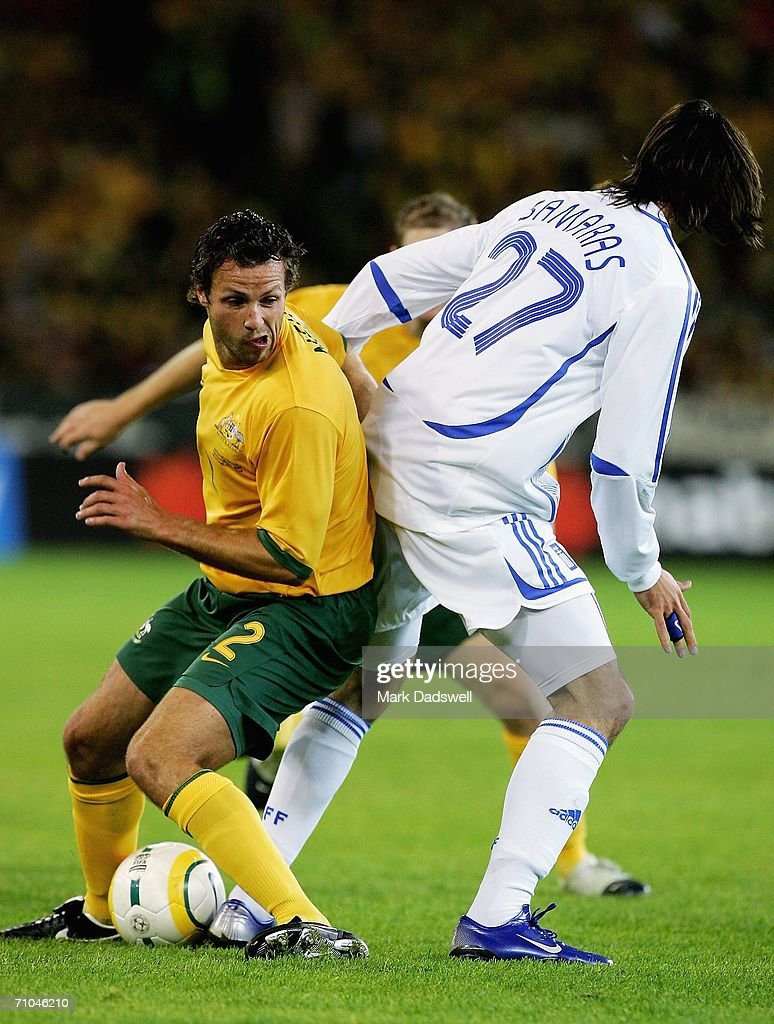 Lucas Neil of Australia controls the ball despite the efforts of Georgios Samaras of Greece during the Powerade Cup international friendly match between Australia and Greece at the Melbourne Cricket Ground May 25, 2006 in Melbourne, Australia.