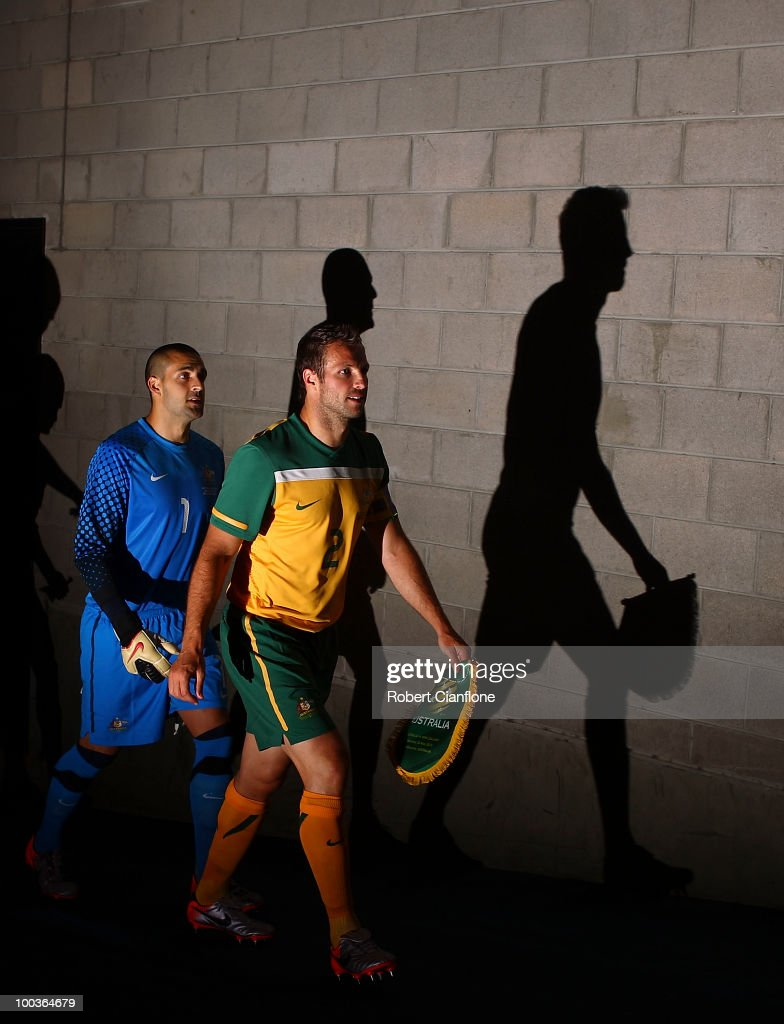 <a gi-track='captionPersonalityLinkClicked' href=/galleries/search?phrase=Lucas+Neill&family=editorial&specificpeople=213118 ng-click='$event.stopPropagation()'>Lucas Neill</a> and <a gi-track='captionPersonalityLinkClicked' href=/galleries/search?phrase=Adam+Federici&family=editorial&specificpeople=886953 ng-click='$event.stopPropagation()'>Adam Federici</a> of Australia walk up the players tunnel prior to the 2010 FIFA World Cup Pre-Tournament match between the Australian Socceroos and the New Zealand All Whites at Melbourne Cricket Ground on May 24, 2010 in Melbourne, Australia.
