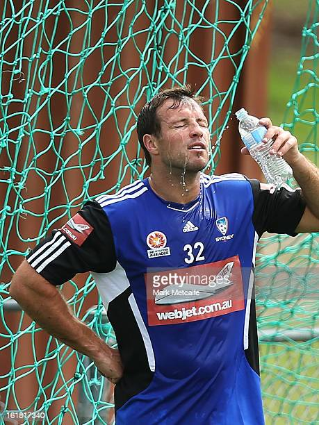 Lucas Neill cools off during a Sydney FC ALeague training session at Macquarie Uni on February 17 2013 in Sydney Australia