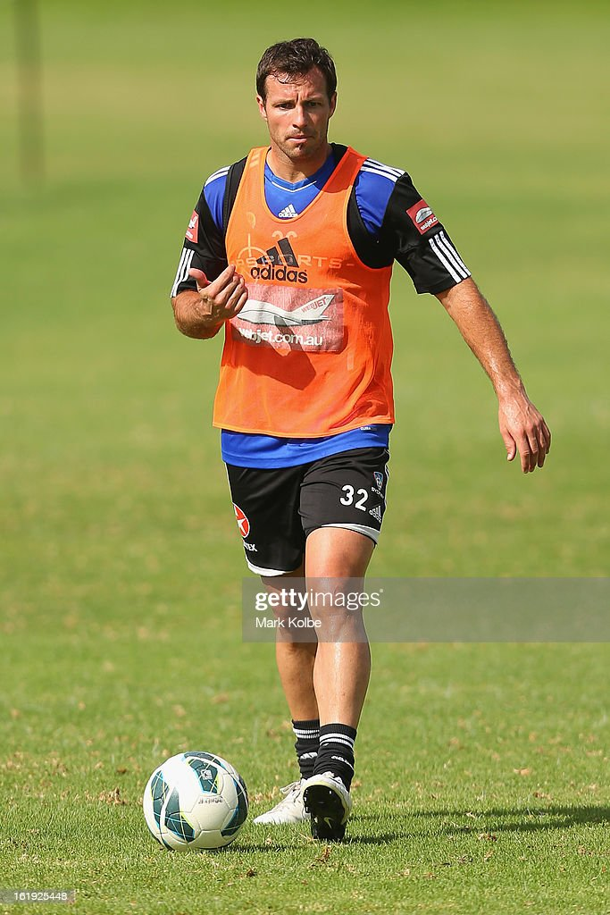 <a gi-track='captionPersonalityLinkClicked' href=/galleries/search?phrase=Lucas+Neill&family=editorial&specificpeople=213118 ng-click='$event.stopPropagation()'>Lucas Neill</a> looks to pass during a Sydney FC A-League training session at Macquarie Uni on February 18, 2013 in Sydney, Australia.