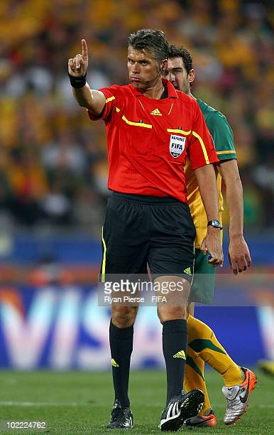 Lucas Neill of Australia appeals to referee Roberto Rosetti during the 2010 FIFA World Cup South Africa Group D match between Ghana and Australia at...