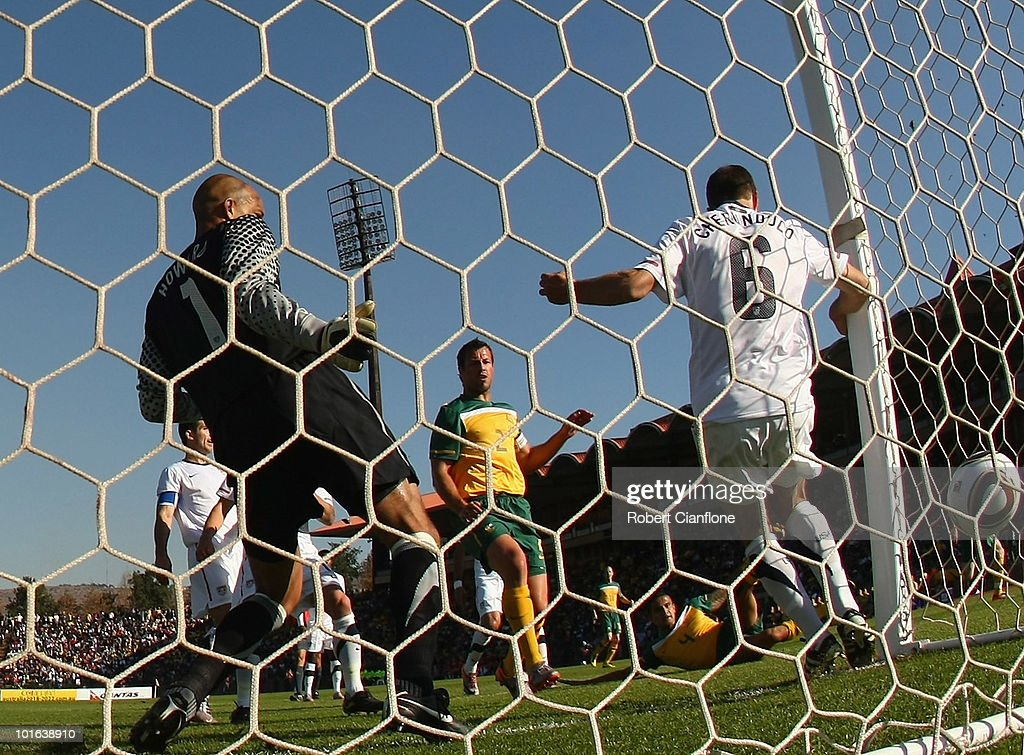 Lucas Neill of Australia celebrates as Tim Cahill of Australia scores past USA goalkeeper Timothy Howard and player Steven Cherundolo during the International Friendly between the Australian Socceroos and the USA at Ruimsig Stadium on June 5, 2010 in Roodepoort, South Africa.