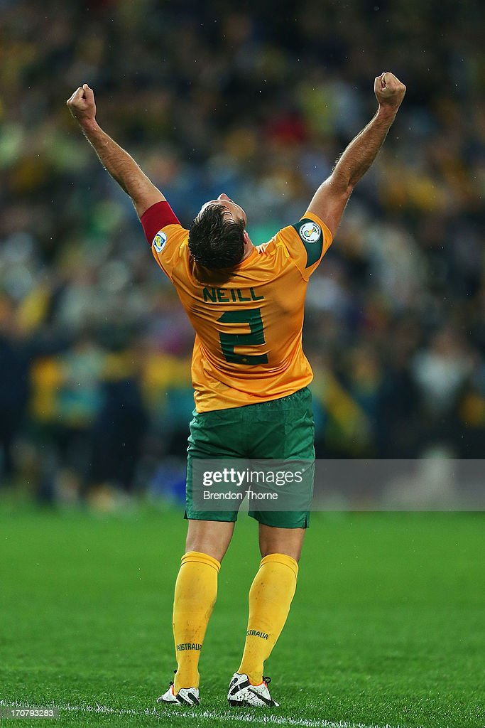 <a gi-track='captionPersonalityLinkClicked' href=/galleries/search?phrase=Lucas+Neill&family=editorial&specificpeople=213118 ng-click='$event.stopPropagation()'>Lucas Neill</a> of Australia celebrates at full time after victory over Iraq during the FIFA 2014 World Cup Asian Qualifier match between the Australian Socceroos and Iraq at ANZ Stadium on June 18, 2013 in Sydney, Australia.