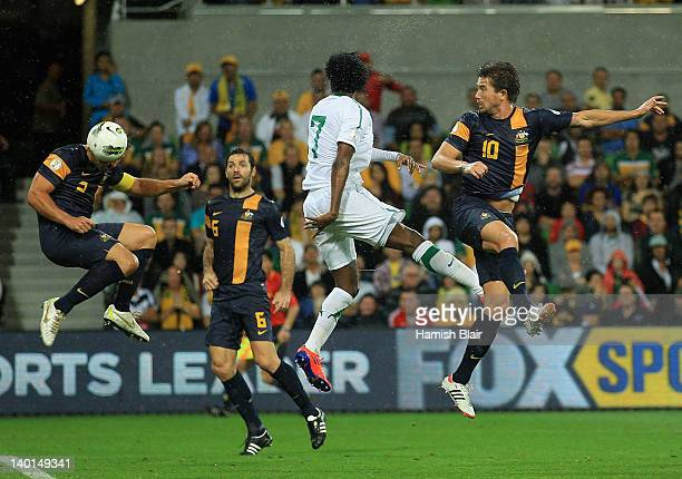 Lucas Neill of Australia heads in a goal which was disallowed after he was ruled offside during the Group D 2014 FIFA World Cup Asian Qualifier match...