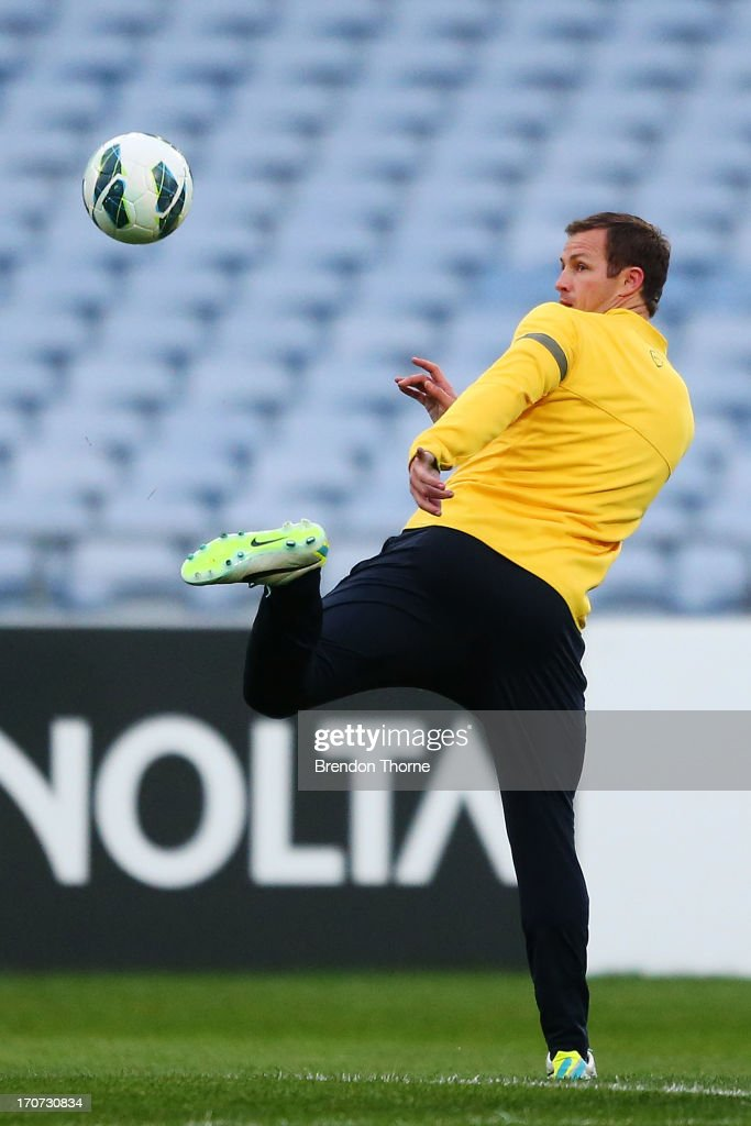 <a gi-track='captionPersonalityLinkClicked' href=/galleries/search?phrase=Lucas+Neill&family=editorial&specificpeople=213118 ng-click='$event.stopPropagation()'>Lucas Neill</a> of Australia kicks a ball during an Australian Socceroos training session at ANZ Stadium on June 17, 2013 in Sydney, Australia.