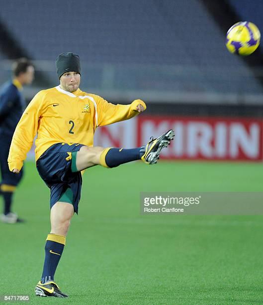 Lucas Neill of Australia kicks the ball during the Australian training session at Nissan Stadium on February 10 2009 in Tokyo Japan